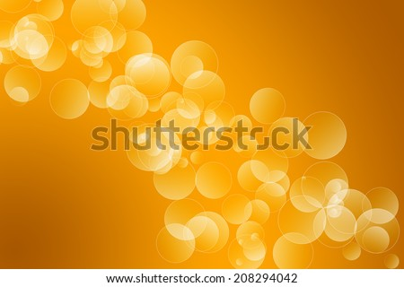 Orange gradient background with random circles in a bokeh effect - stock photo