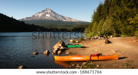 Orange Green Kayaks Shoreline Trillium Lake Mt. Hood Oregon Cascades - stock photo