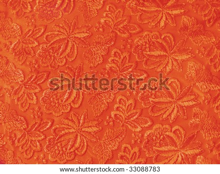 Orange guipure, embroidery on cloth, texture - stock photo