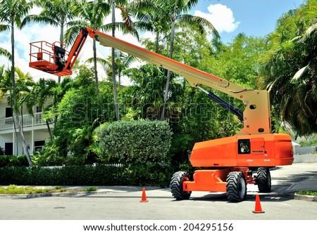 Orange Heavy Duty Industrial Lift Bucket Cherry Picker Machine - stock photo