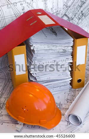 Orange helmet, design drawings and file folders on the table. Business still life - stock photo