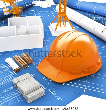 Orange Helmet for Builder and Blueprints - stock photo