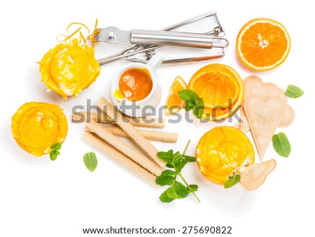 Orange ice cream and ingredients isolated on white background, top view  - stock photo