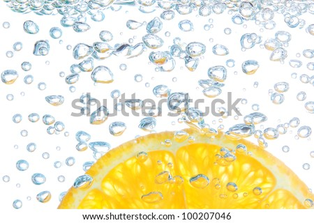 Orange in a liquid with bubbles. On a white background. - stock photo