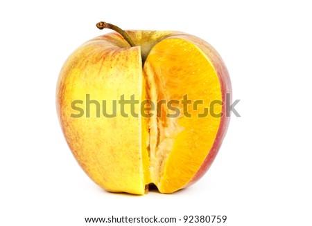 Orange in apple. Modification concept. - stock photo