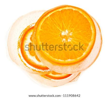 orange in ice on a white background - stock photo
