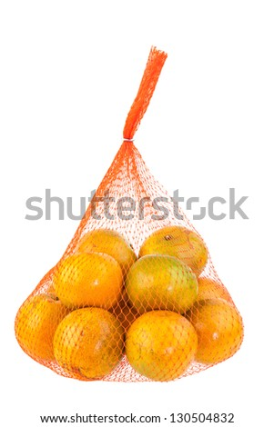 Orange in mesh bag on white background - stock photo