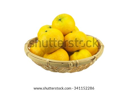 Orange in wooden basket on a white background. - stock photo