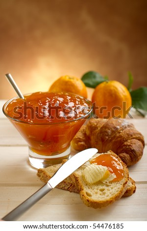 orange jam with toast and croissant - stock photo