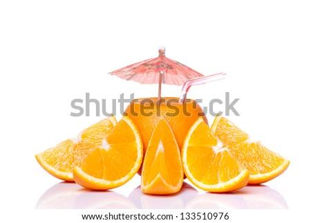 Orange juice and a pieces of sliced orange on white background. Studio shot - stock photo