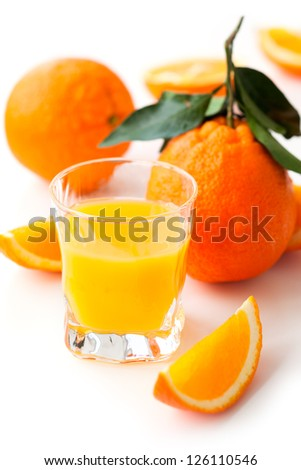 Orange juice and fruits on the white table - stock photo