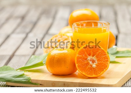 orange Juice and orange on the cutting board - stock photo