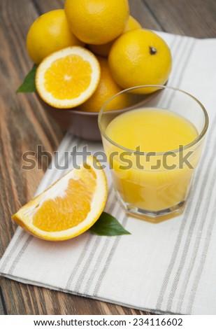 Orange juice freshly squeezed from fresh fruits  - stock photo