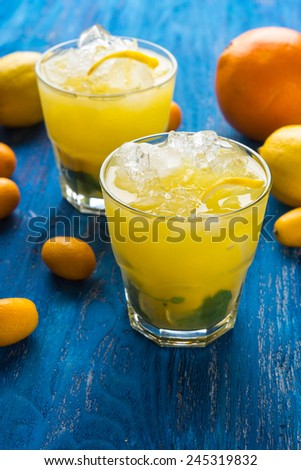 Orange juice, ice, lemon and mint in the glass