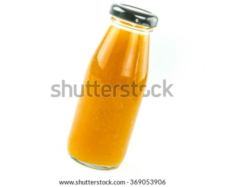 Orange juice in a bottle on a white background. - stock photo