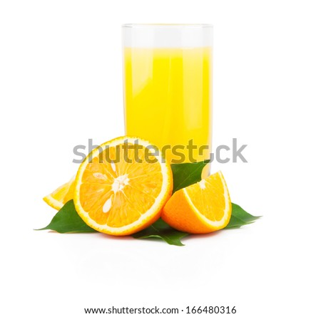 Orange juice in glass jar and oranges fruit with green leaves