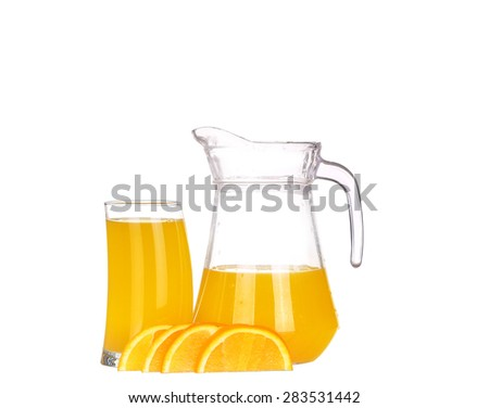Orange juice in pitcher and oranges. Isolated on white background - stock photo
