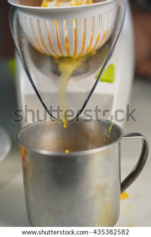 Orange juice maker squeezer closeup - stock photo