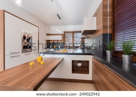 Orange juice on countertop in luxury kitchen - stock photo