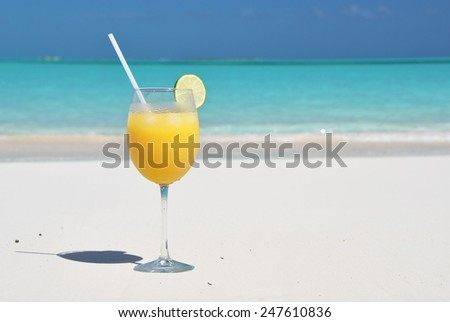Orange juice on the beach. Great Exuma, Bahamas - stock photo