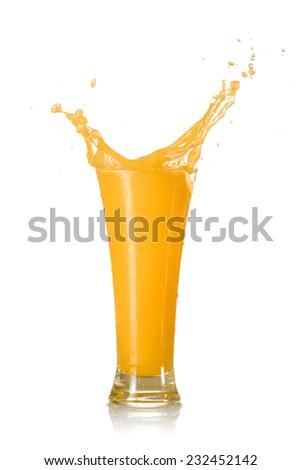 Orange Juice Splash in A Glass Isolated on White Background - stock photo