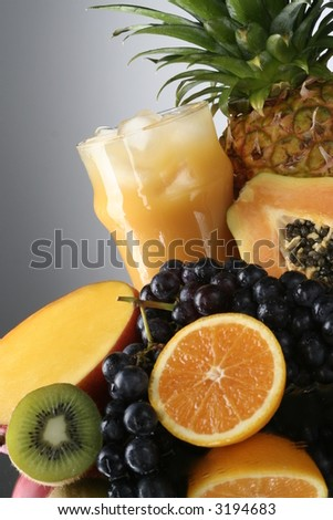 Orange juice with fruits selection - stock photo