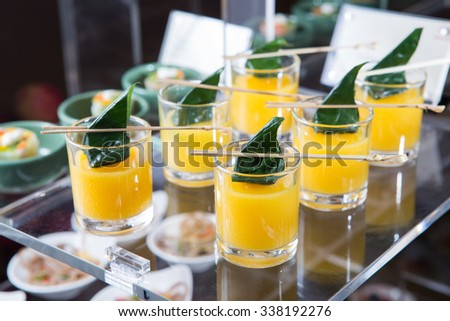 Orange juice with mint, drink, appetizer, delicious finger food setup in Hotel - stock photo