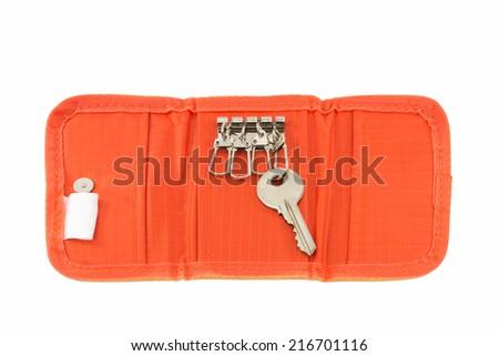 orange Key pocket on white background - stock photo