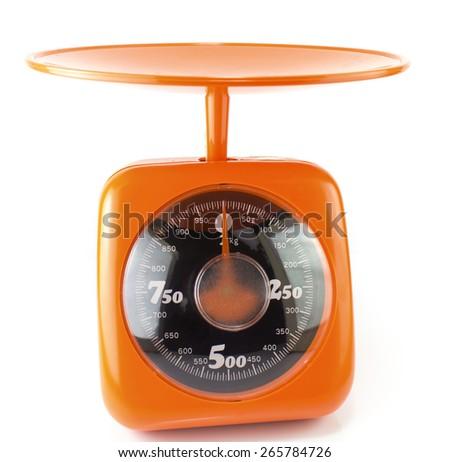 orange  kitchen scale isolated on white - stock photo
