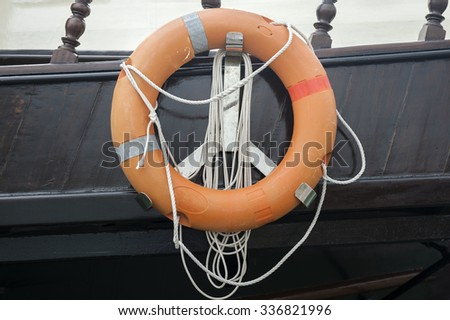 Orange Life buoy on of a cruise ship. - stock photo