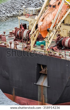 Orange lifesaving boat on tanker back closeup - stock photo