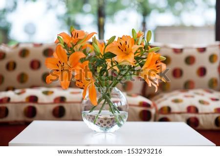 orange lilies in a vase - stock photo
