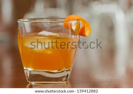 orange liquor served on the rocks with an orange twist as a garnish - stock photo