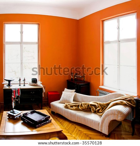 Orange living room with vintage style furniture - stock photo
