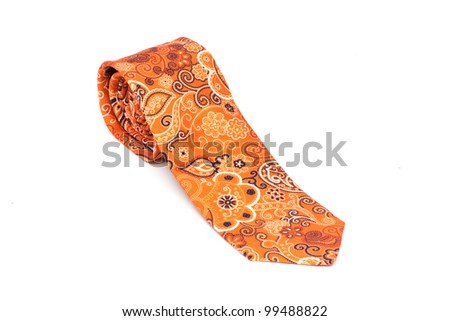 Orange male tie  rolled and isolated on white - stock photo