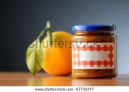orange marmelade in a labelled and not branded can - stock photo