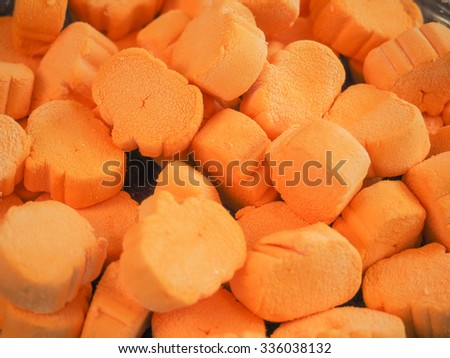 Orange marshmallows in a bowl served at Halloween party. - stock photo
