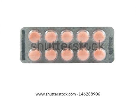 Orange medicine tablet in transparent blister pack - stock photo