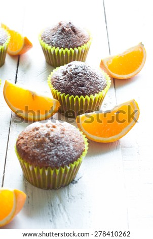 Orange muffins at the  table. Selective focus. - stock photo