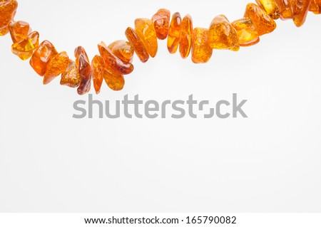 Orange natural amber necklace with space for copy text - stock photo