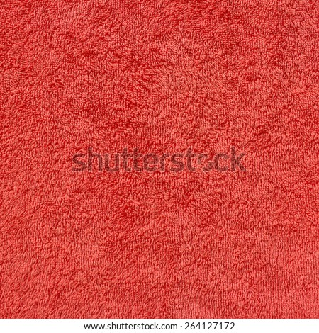 Orange natural plush terry cloth turkish bath / beach bathroom towel, textured fabric macro background closeup texture