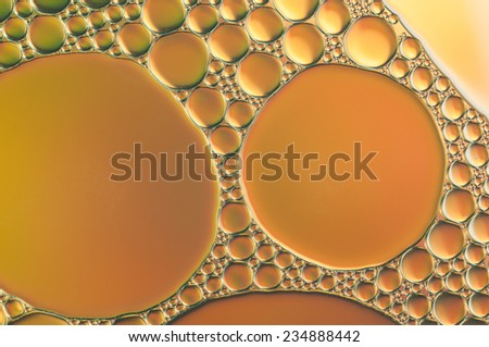 orange oil bubbles on a water surface abstract background - stock photo