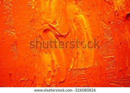 orange oil paint on a palette - stock photo