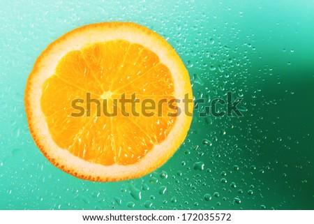 Orange on green background - stock photo