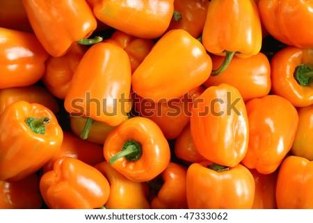 Orange pepper background - stock photo
