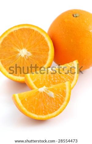 Orange pieces put together with fresh orange isolated on white background. - stock photo