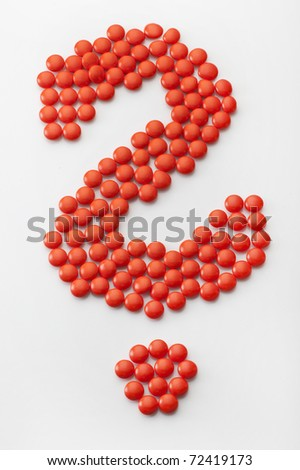 orange pilll as question-mark - stock photo