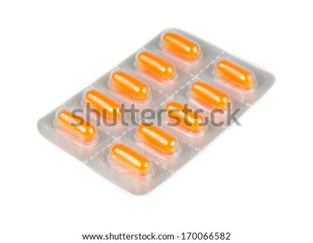 orange pills packed in blister isolated on white background - stock photo