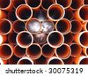 Orange pipes for waste water - stock photo