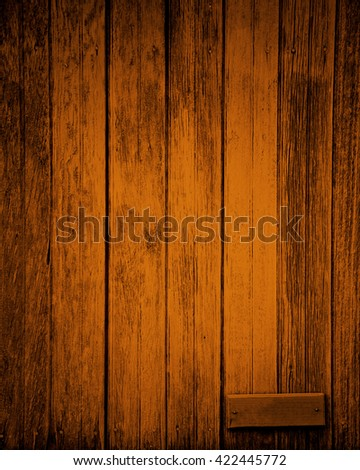 orange plank with small blank sign for text - stock photo